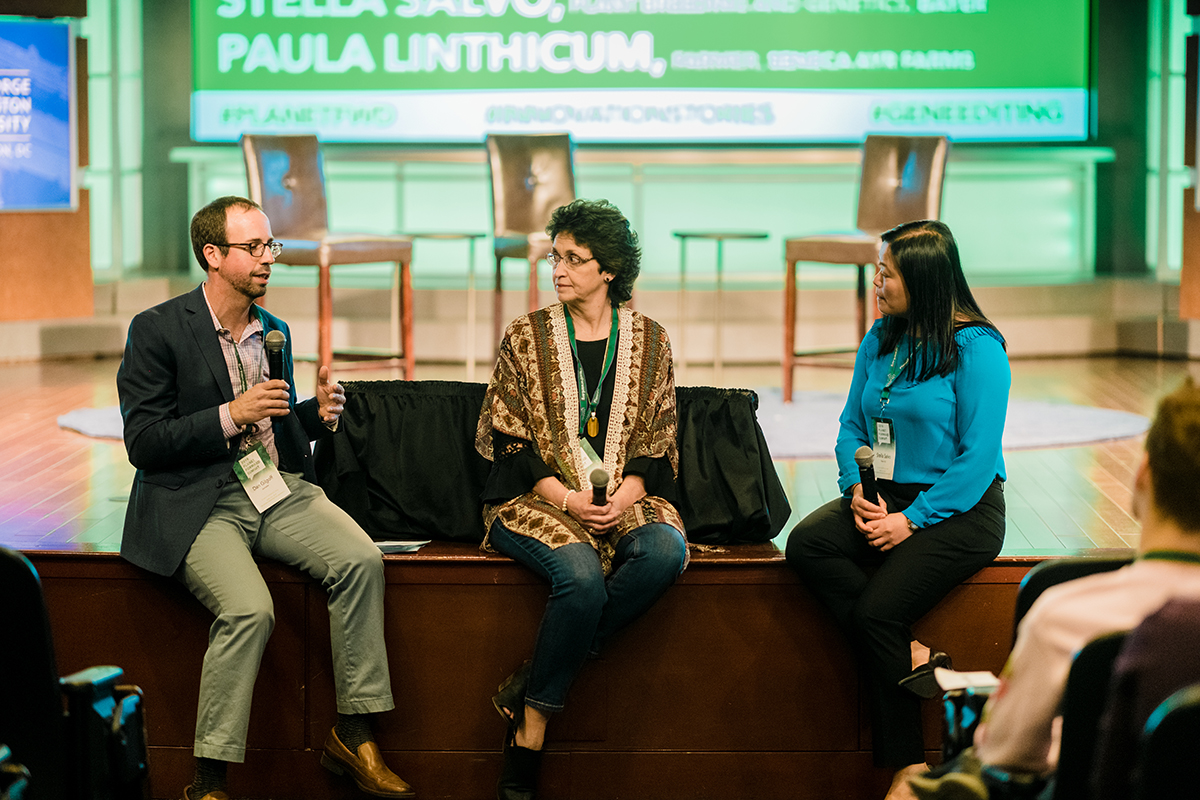 Journalist Dan Gilgoff, moderates a breakout session on gene editing, featuring speakers Paula Linthicum, co-owner of Seneca Ayr Farm, and Stella Salvo, a plant breeder and geneticist from Bayer.