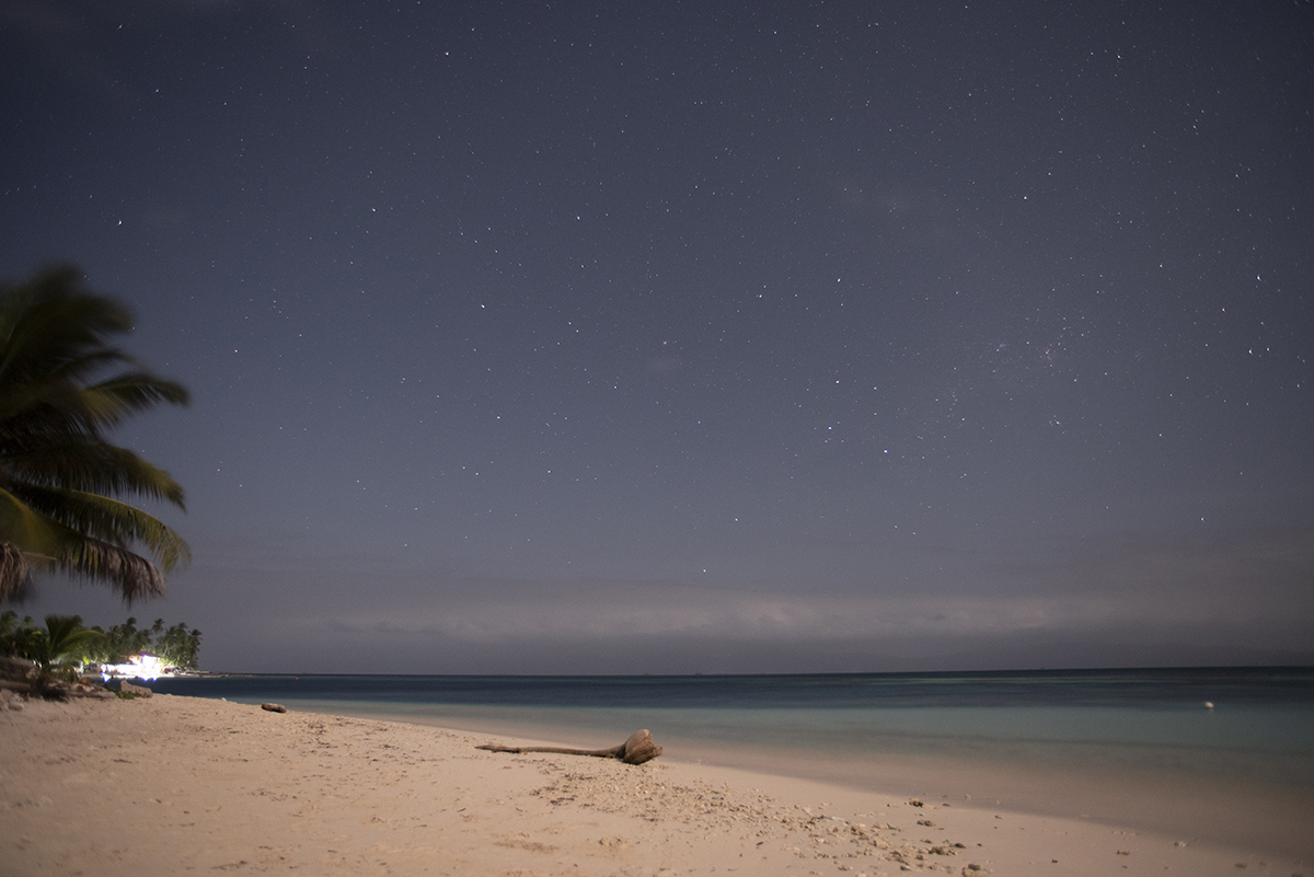 Located in the indigenous province of Guna Yala a few miles north of the Panamanian coast, stars shine through a hazy night on Isla Diablo (Niadub) in March 2018.