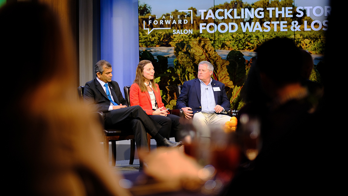 Vimlendra Sharan and Chip Bowling are joined on stage with Meghan Chapple, Director of GW's Office of Sustainability.