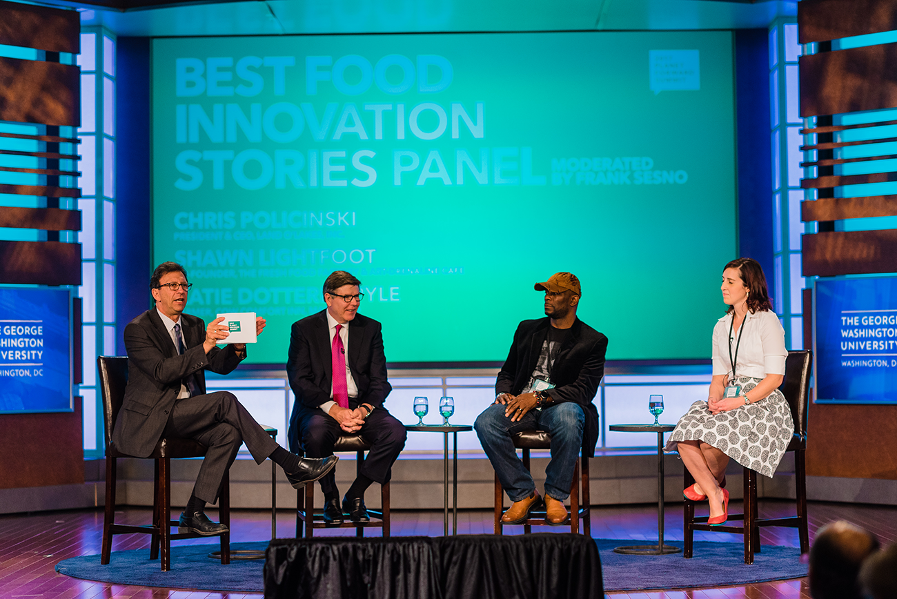 Frank Sesno (left) engages Land O'Lakes CEO Chris Policinski (left-center), Fresh Food Factory Co-Founder Shawn Lightfoot (right-center), and Cow Comfort Inn Owner Katie Dotterer-Pyle (right) in a conversation about innovation.