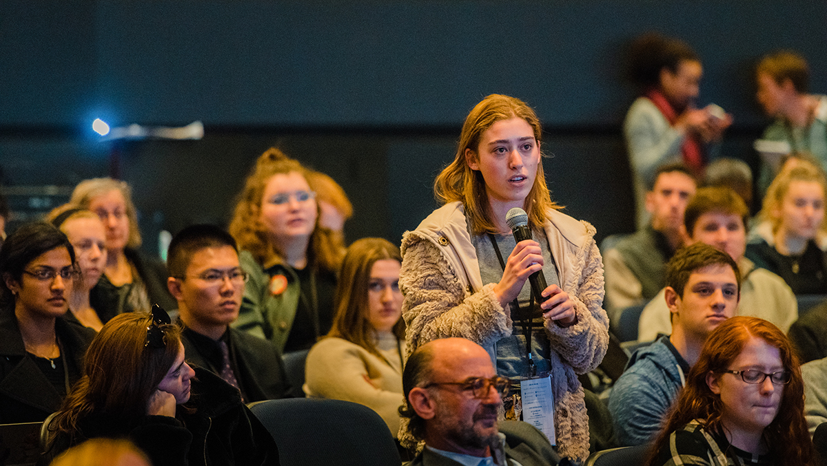 An audience member asks The New York Times Climate Editor, Hannah Fairfield, a question after her presentation.