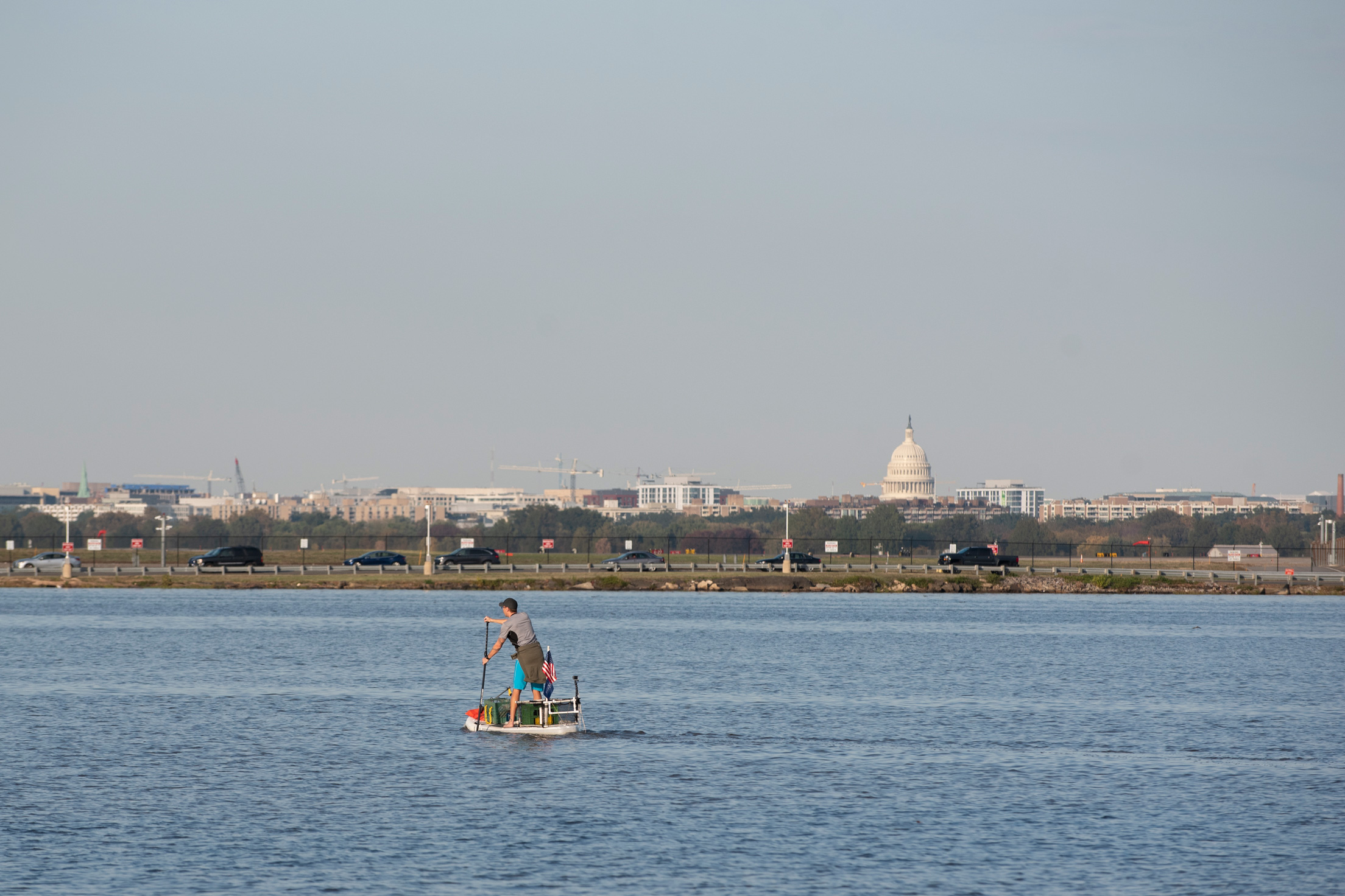The United States Capitol Building is seen from a distance as Joseph Wright paddles down the Potomac River on November 5, 2019 in Alexandria, VA.