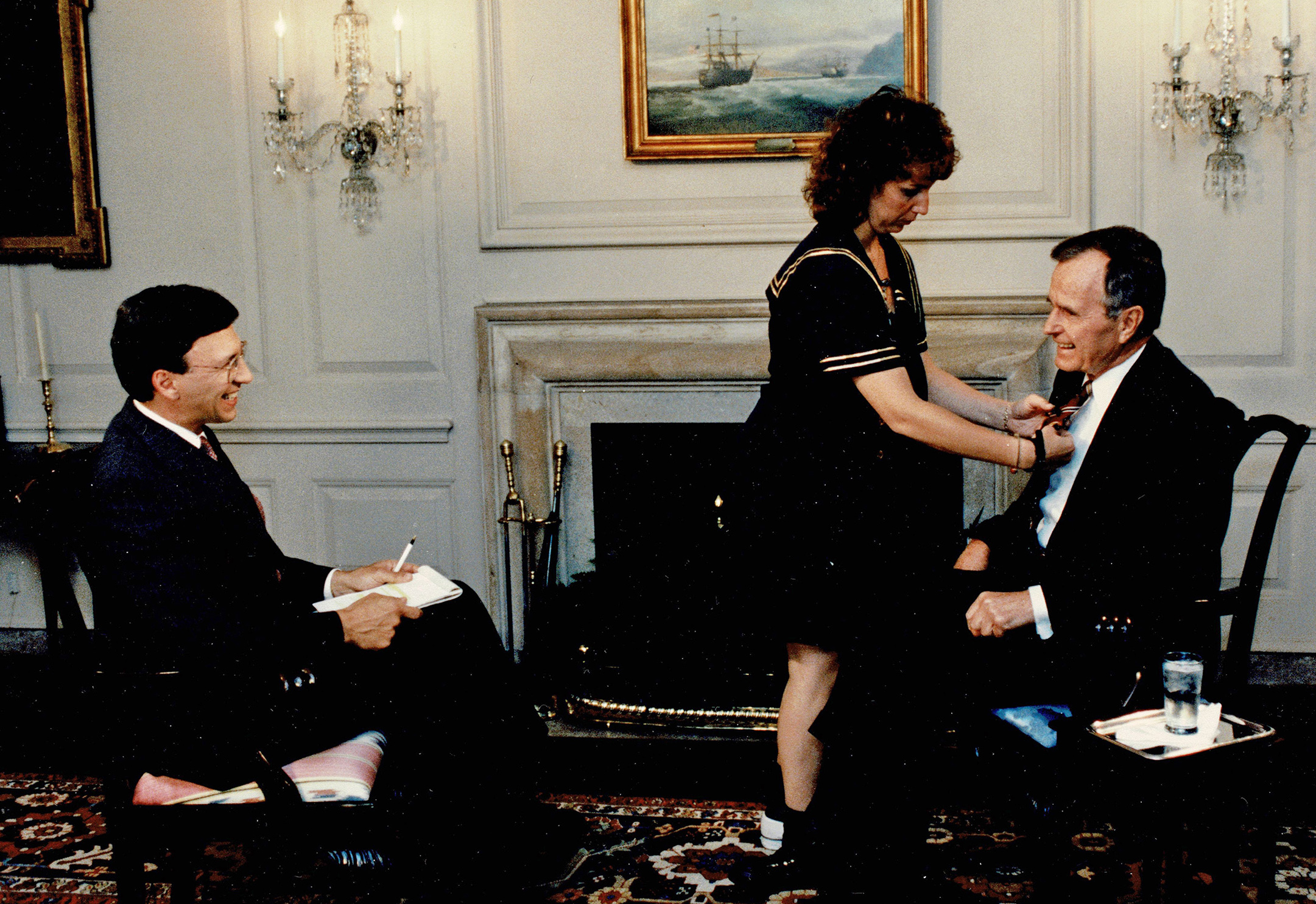 Sesno and then-President George H.W. Bush get set up for an interview at the White House for CNN.