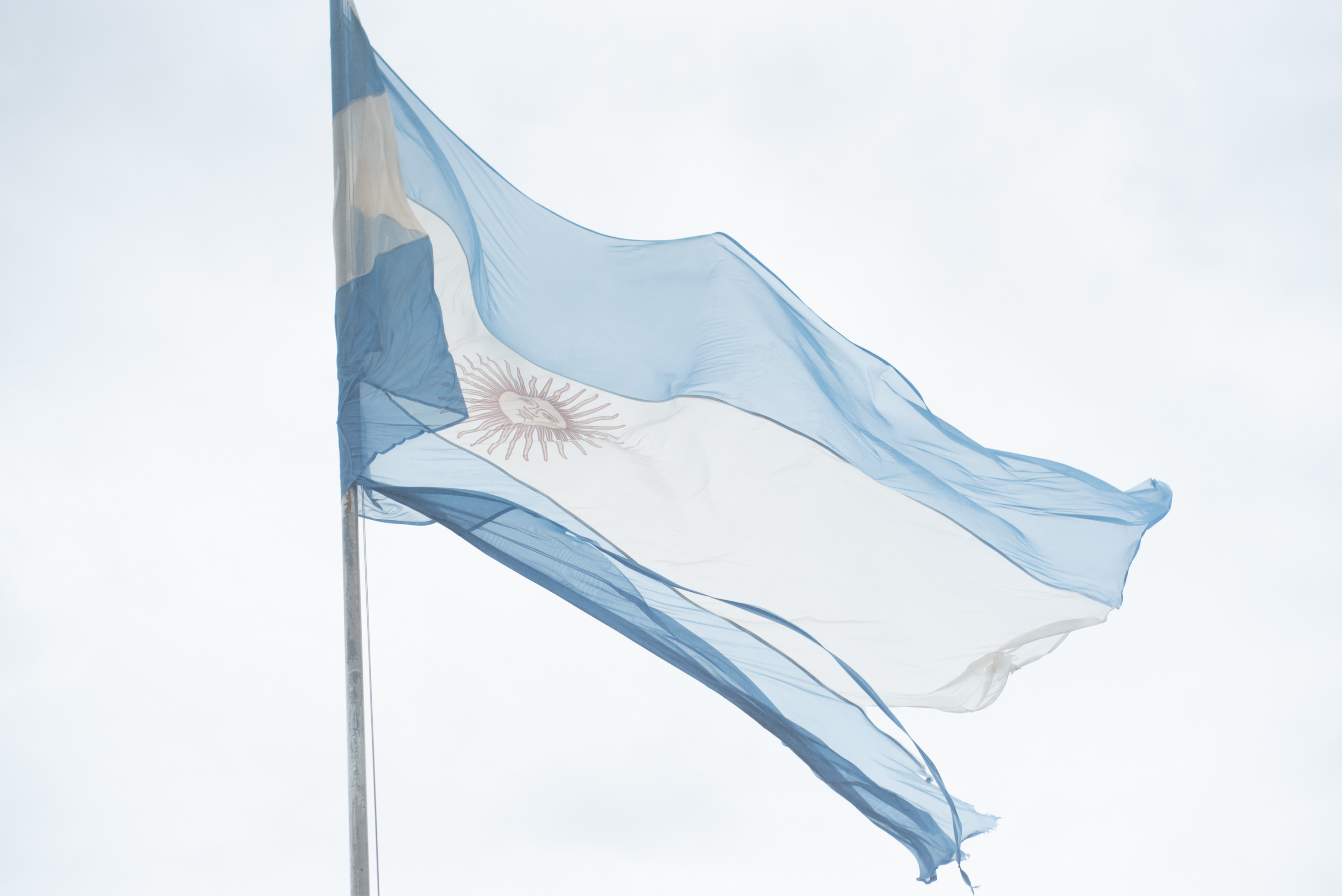 The Argentine flag waves in the misty air near the Devil's Throat on the Argentine side.