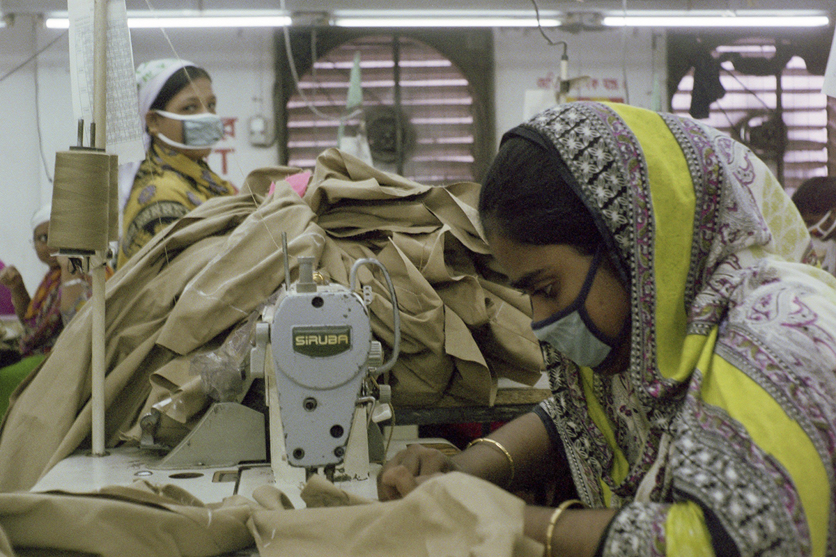 Garment workers sewing khaki pants in the Intramex Group Factory.