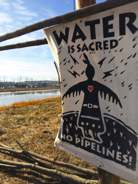 Print of Action: The Keystone Pipeline threatens the water that runs through the Sioux burial grounds. It threatens the sanctity of the Sioux ancestors resting in peace below the surface. This print is earned while at the camp; a symbol of pride for those who attain one.