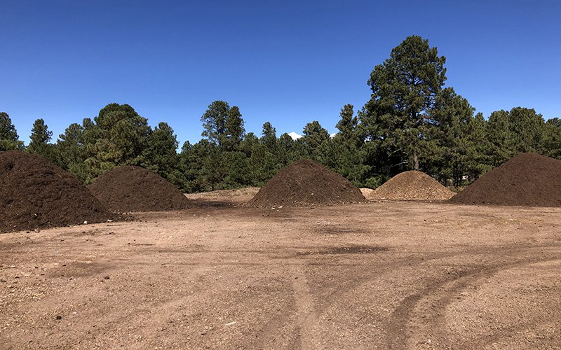 Compost piles are separated by how old each pile is on Northern Arizona University's campus. The majority of dining hall food waste is used to create these dirt piles.