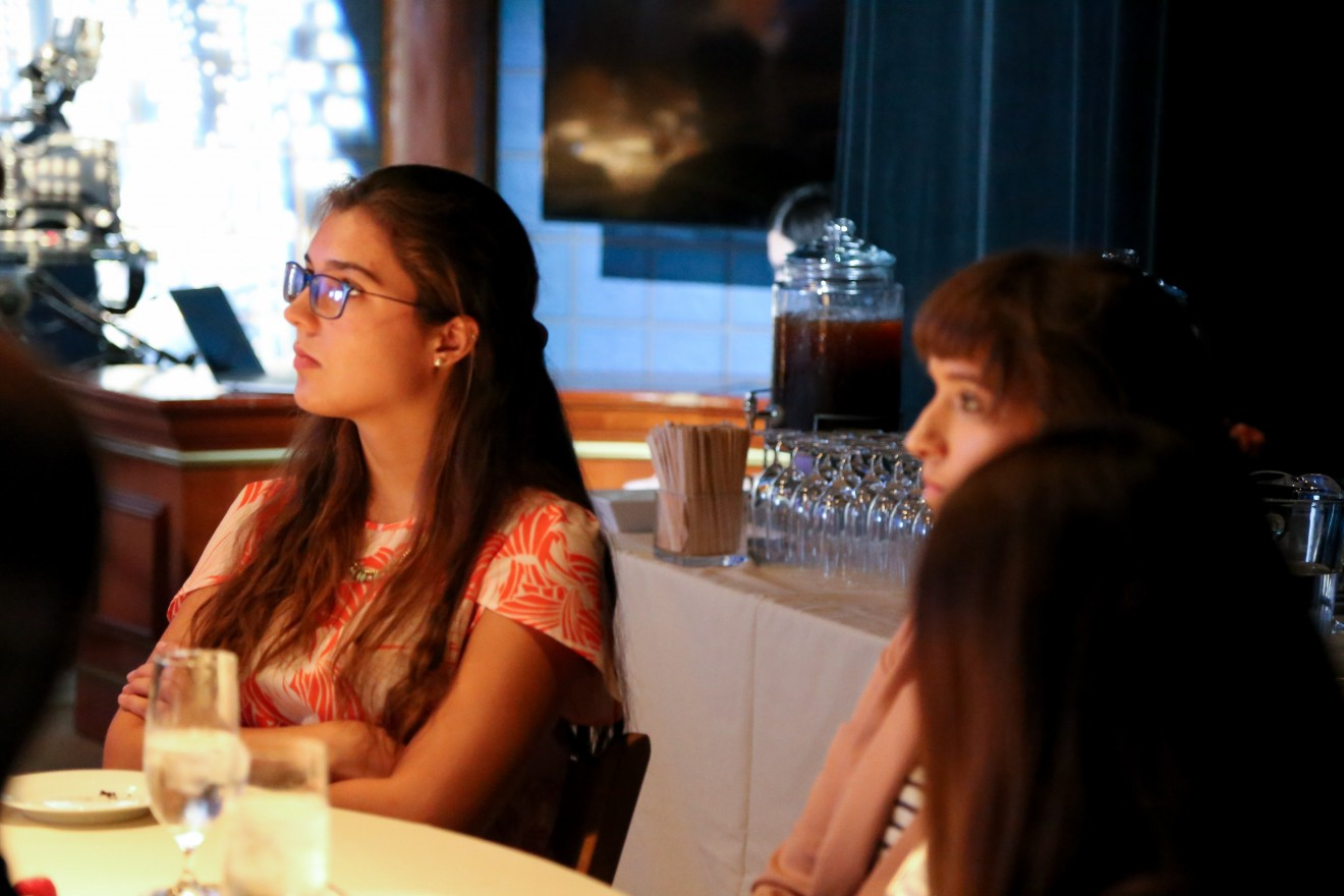 Christina Sivulka, a student fellow with the GW Food Institute, listens intently to the conversation. The GW Food Institute is a collaborative of student scholars and faculty engaged in research about sustainable food systems.