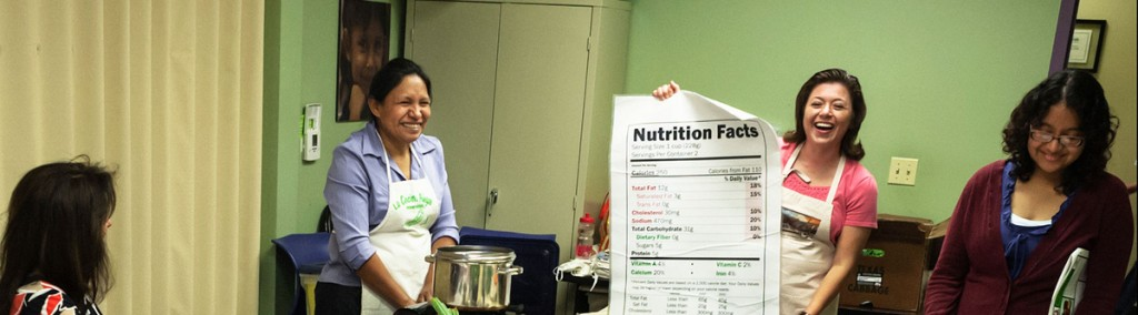 Facilitators engage students in a discussion about nutrition fact labels. (Photo courtesy of The Happy Kitchen)
