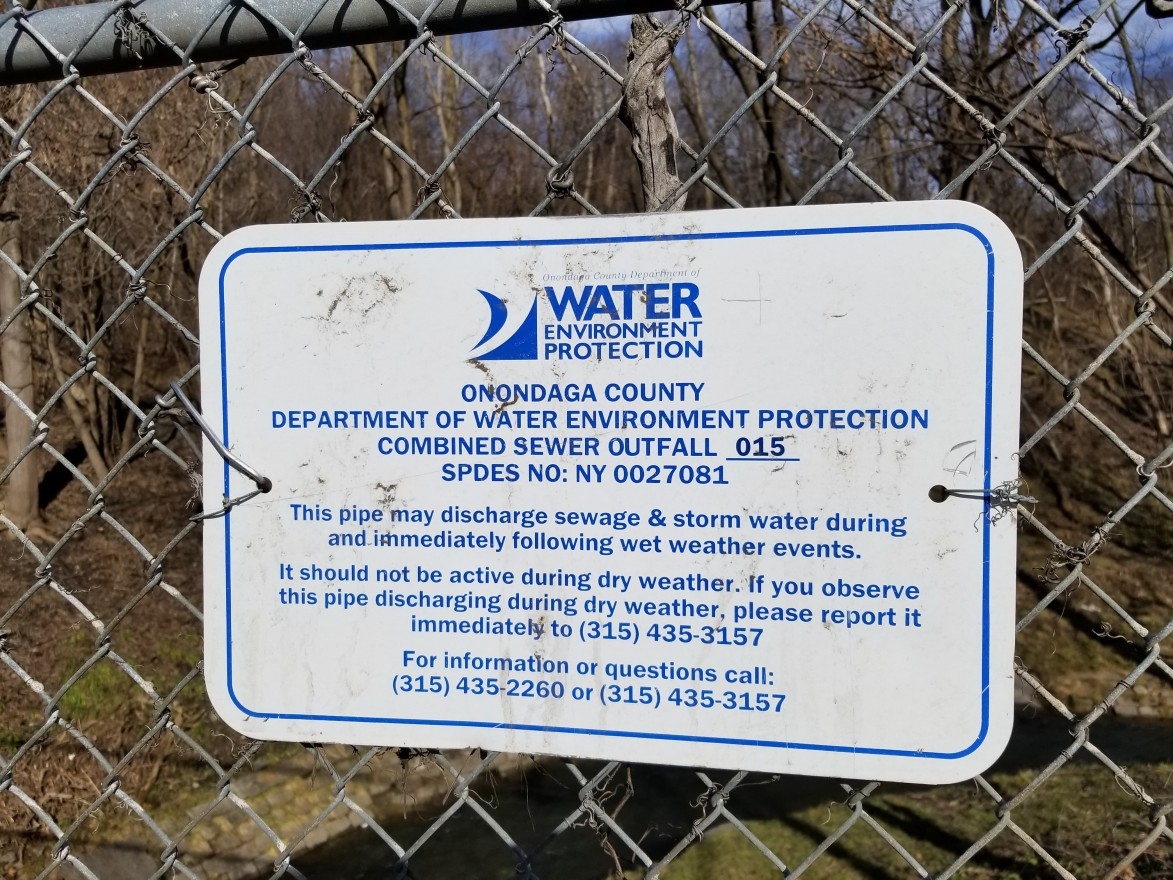 A sign warns residents of the possibility of combined sewer overflows. (Lauren Tarr)