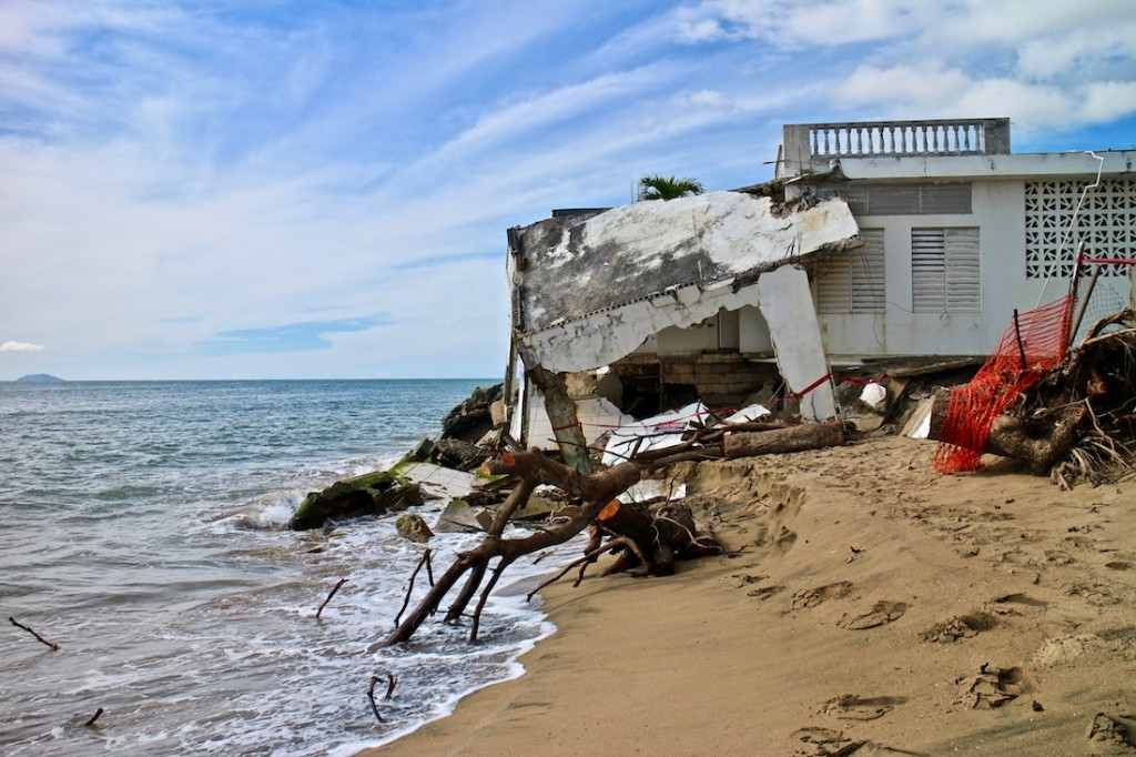 "Rising sea levels affect all coastal communities in Puerto Rico, including the popular surfing destination of Rincón. ""If you're located on the beach, it doesn't care if you're rich or poor,"" said Ruperto Chaparro. (Janice Cantieri/MEDILL)"
