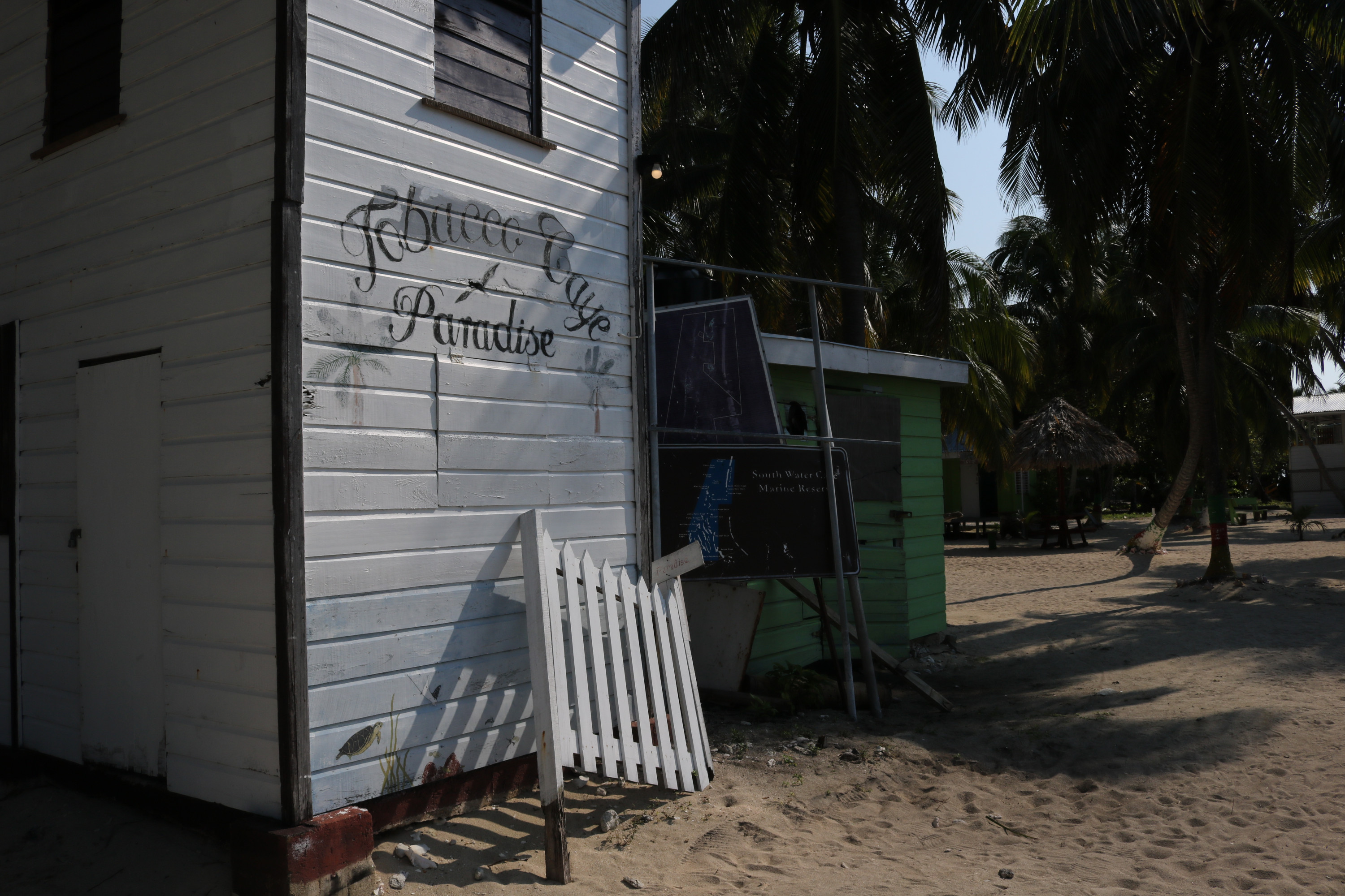 Sign on building welcoming visitors to the tobacco caye