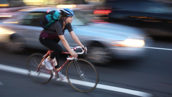 Cycling alongside DC traffic can be dangerous. (Photo courtesy of WABA)