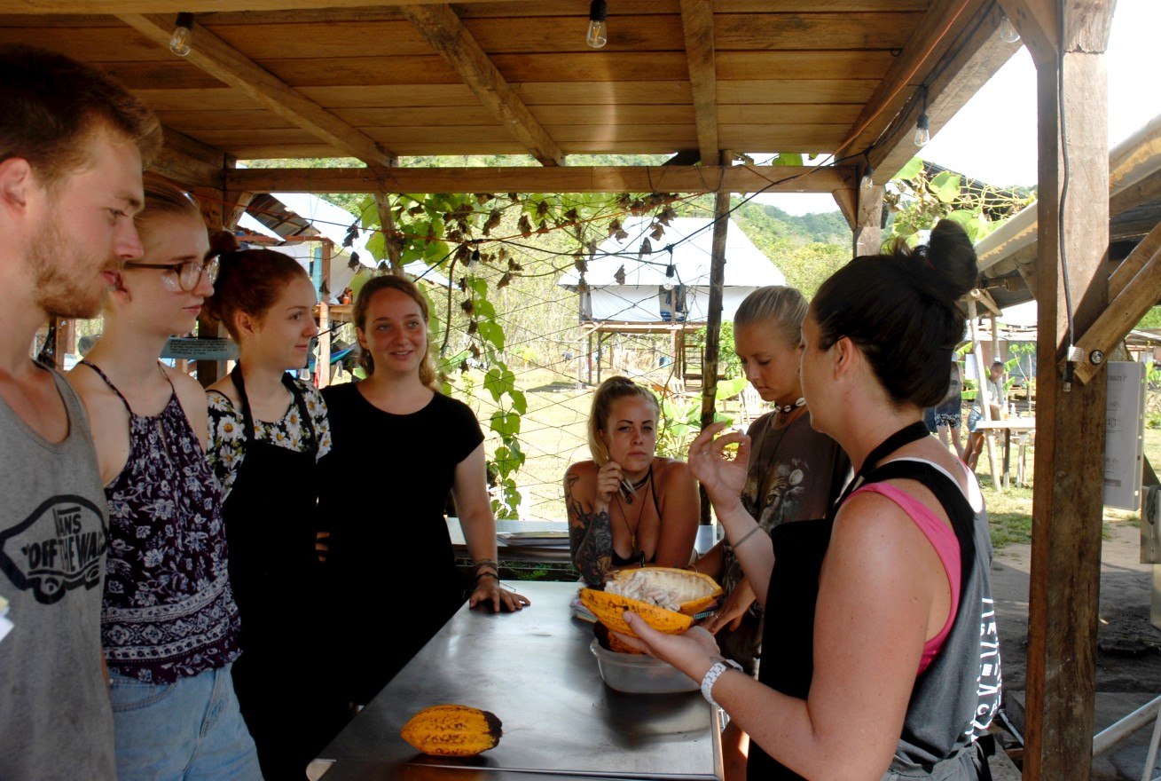 Diamond and her fellow culinary interns learn how to properly open a cacao bean with culinary teacher Kerri Selby.