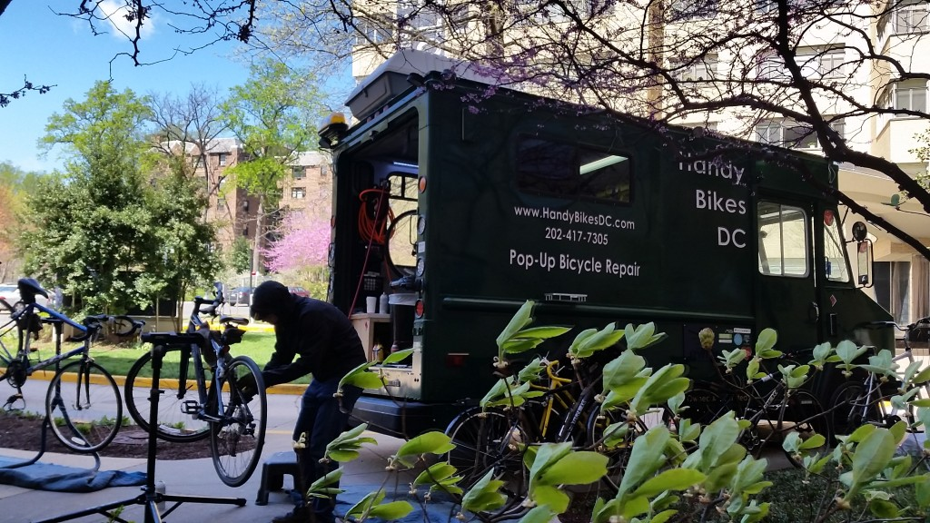 Handy Bikes DC hard at work repairing a bicycle. (Photo courtesy of Peter Buck, Handybikes DC)
