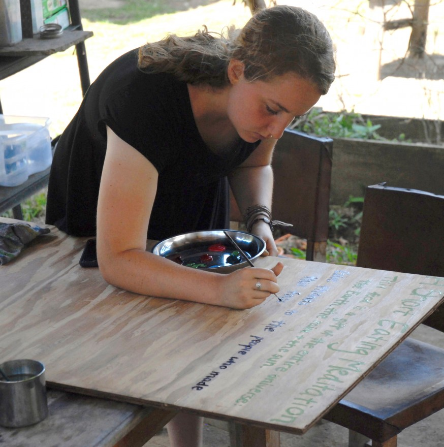 Diamond begins painting the final product of her mindful eating project, a sign to hang at Kalu Yala for future interns and residents to consider.