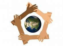 hands surrounding the planet