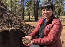 Gaby Galvan holds compost on campus