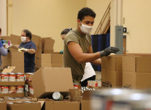 Staff fill boxes with food at Pittsburgh area food bank