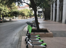 scooters on the sidewalk