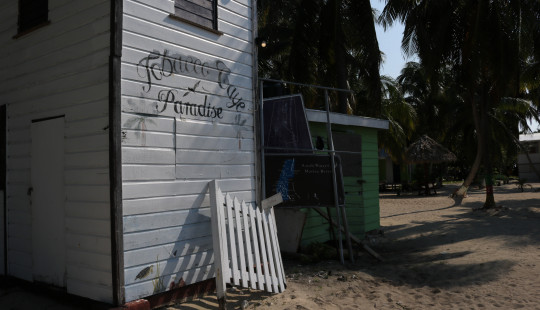 Sign on building welcoming people to the tobacco caye