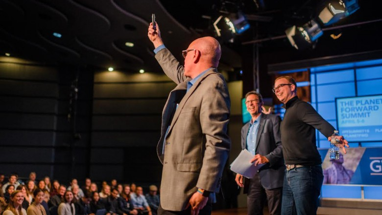 Adobe's Stephen Hart takes a 360-degree photo from the stage with Steve Johnson and Frank Sesno hamming it up.