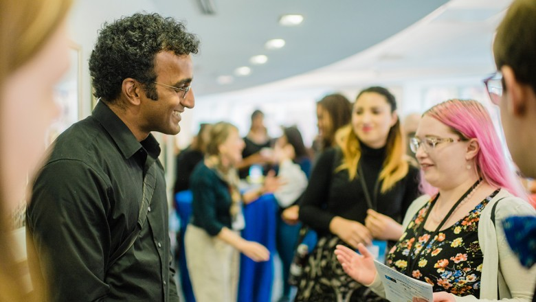 Following his keynote, Anand Varma joined the networking session upstairs. Here, he's speaking with SUNY-ESF student and Storyfest finalist, Janet Rogers.