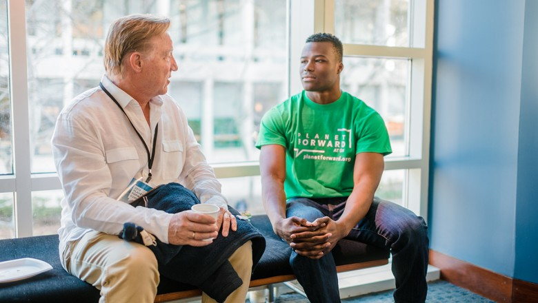 Planet Forward Advisory Board Member and University of Arizona professor Jim Buizer speaks with Eloka Obi, a statistics and environmental studies major at The George Washington University. The two networked at last year's event and were catching up.