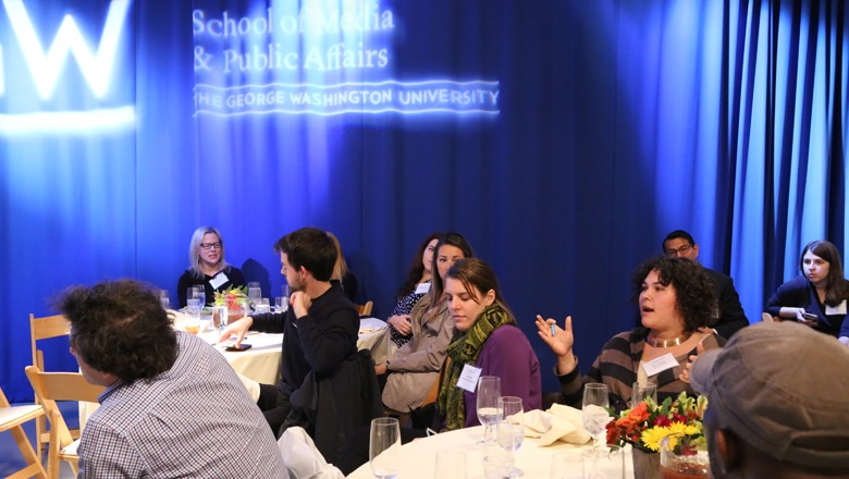 Kayla Williams, right, attending the salon as a fellow with the GW Food Institute, asked about reaching new audiences.