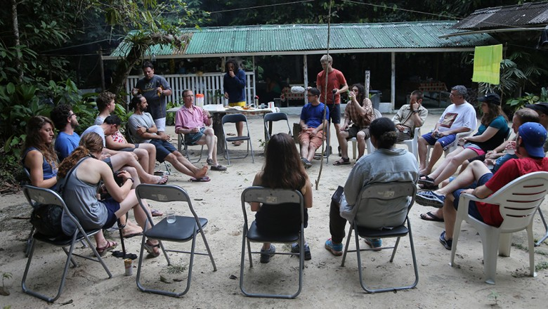 The group comes together on the first night at Camp 41 for happy hour and story time with Tom Lovejoy. (Planet Forward)
