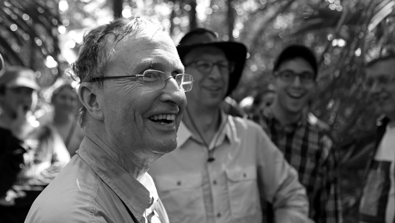 Tom Lovejoy laughs at a question posed by the group. (Planet Forward)