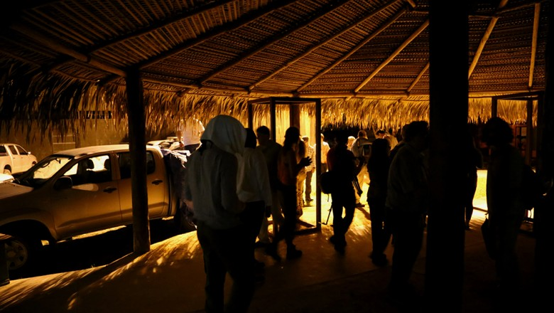 The group grabs coffee before dawn, prior to climbing the 242 steps of the observation tower to see the tree canopy at the Botancial Garden & Museum of the Amazon. (Planet Forward)