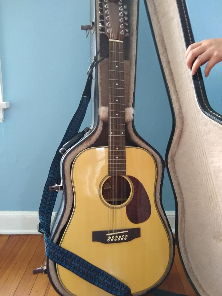 a formerly discarded 12-string guitar