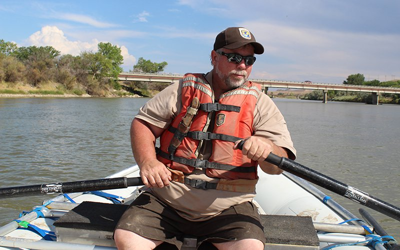 Biologist paddles down river