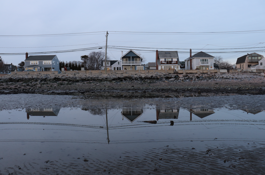 Houses reflected in the Long Island Sound