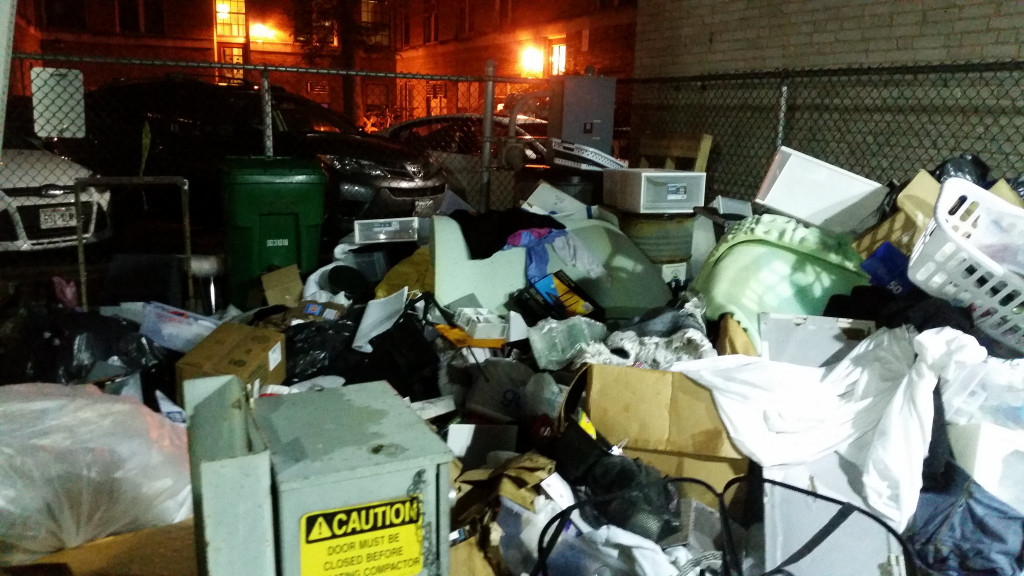 Trash from dorm move-out piled up