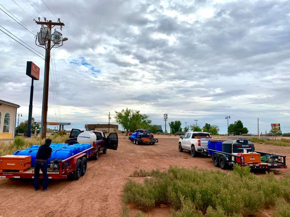 Volunteers with Water Warriors United set out to deliver water across the Navajo Nation.The organization has four 16-foot flatbed trucks that carry 550-gallon tanks, hoses, equipment and a water pump. (Photo courtesy of Water Warriors United)