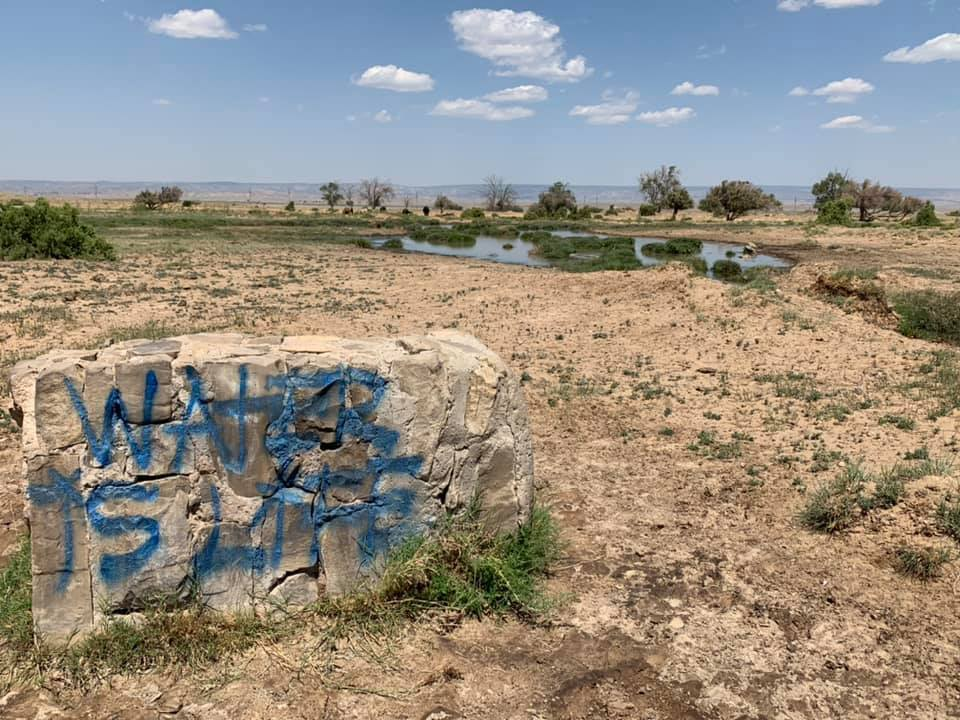 The Navajo people say that water is life, but plentiful, clean water is hard to come by on the reservation. Many households are not good candidates for centralized water systems because extending water lines is expensive. (Photo courtesy of Water Warriors United)